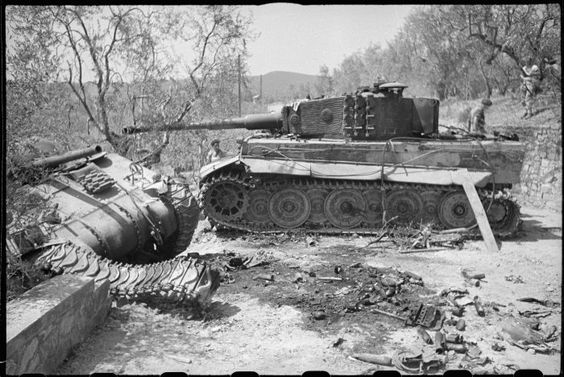 Two wrecked tanks outside the villa Sfacciata, on the road between Giogoli & Galuzzo, south of Florence, Italy. Shows a German Tiger tank from schwere Panzer-Abteilung 508, & a New Zealand Sherman tank, probably from 20th Armoured Regiment. Photograph taken on 4th August 1944 by George Kaye.