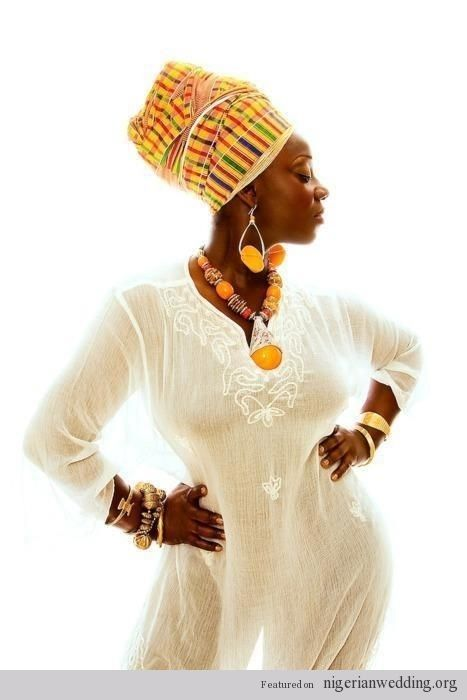 white dress/ caftan with vibrant accessories