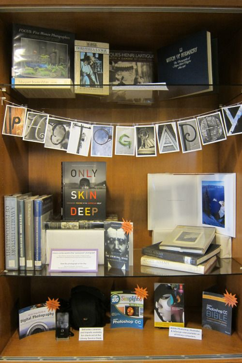 wheelockcollege:  Courtesy of Taylor Kalloch, the Library now has a display about photography and the stories that photographs tell.  Did you know that the Library lends out cameras and that the entire Adobe suite (Photoshop, Illustrator, etc.) is available on all the Library computers?: