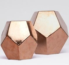 Rose gold decor. Not these exact ones but I am thinking touches of white and modern rose gold would look great!: