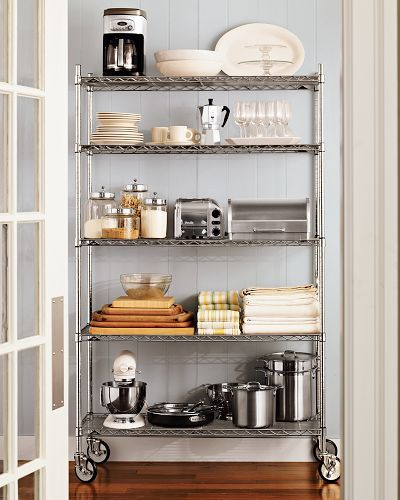 All of Dave's work in the kitchen and he still loves the look of a metro shelf! I think I do too especially since our dishes are white like this photo:
