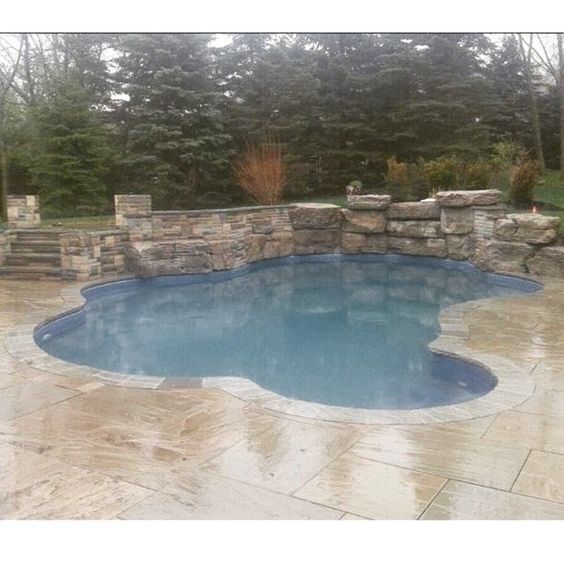 Armour stone waterfall inground pools by pioneer family - Swimming pools burlington ontario ...