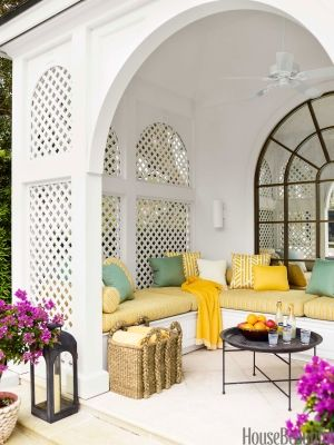 Clean, clear colors put a sophisticated spin on a tropical beach house design by Jesse Carrier and M