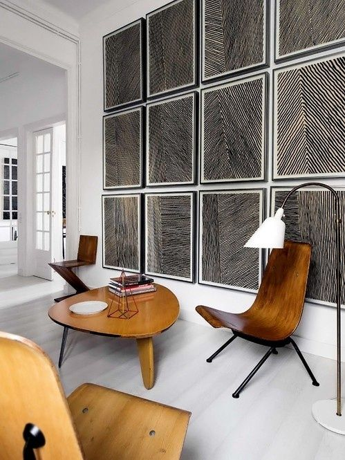 Black, white and natural. Super fresh modern interior design with mid century plycraft chairs