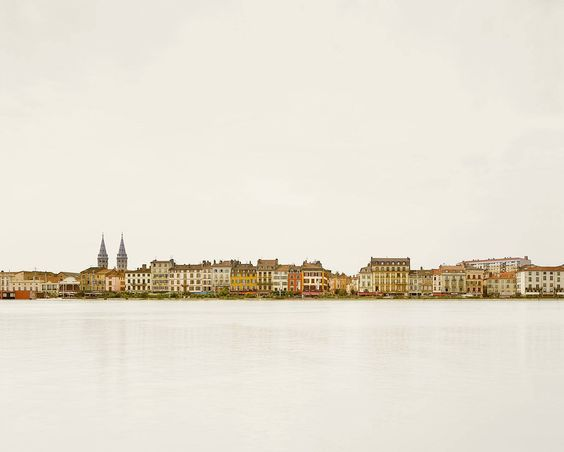 Macon, France, as seen from across the river Saone.  Macon serves as the capital of the Macconais district within Burgundy