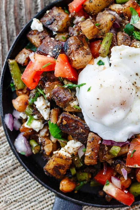 Mediterranean Potato Hash with Asparagus, Chickpeas, and Poached Eggs