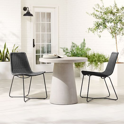 Concrete Pedestal 32 Round Bistro Table 2 Slope Charcoal Dining Chairs West Elm Pedestal Dining Table Round Pedestal Dining Table Bistro Table Outdoor