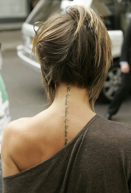 Victoria Beckhams tattoo. That had to hurt a lot tress code | tattoos picture victoria beckham tattoo