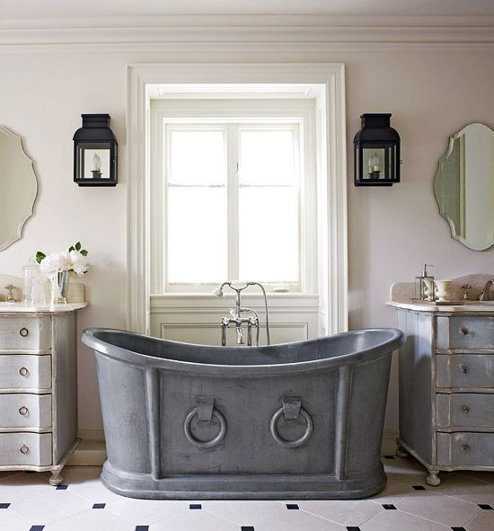 A vintage zinc tub with a deep lilac hue is a stunning focal point in this bathroom. - Traditional Home ® / Photo: Virginia Macdonald / Design: Colette van den Thillart: