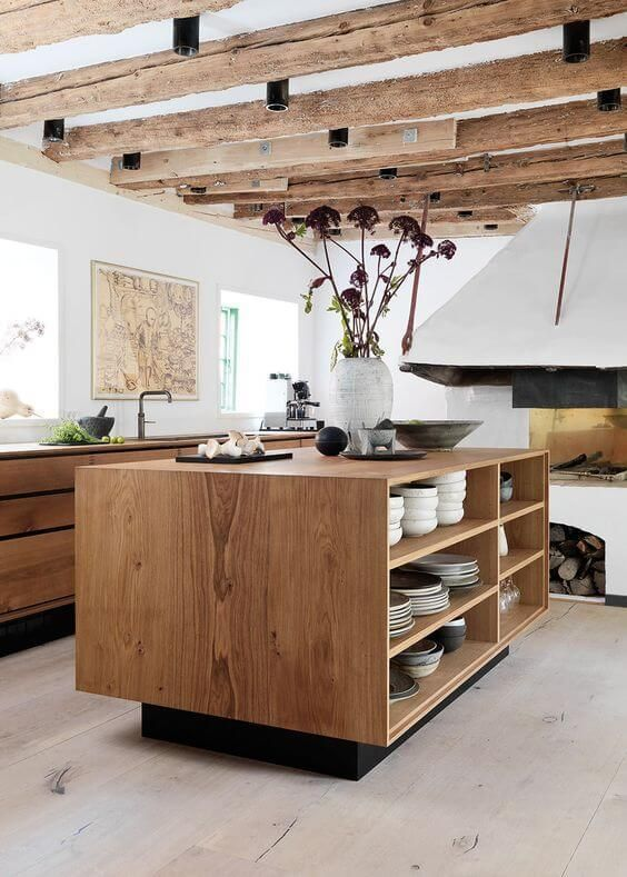 I love the look of this wooden kitchen with the exposed roof joists. Makes the kitchen look interesting and inviting!