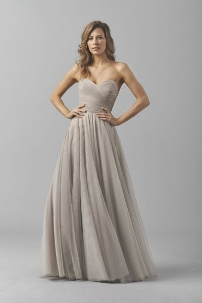 Watters 8360i Bobbinet Bridesmaid Gown- Liz Style 8360i from Watters is a strapless Bobbinet floor length bridesmaid dress with a full A-line, a ruched crisscross bodice and sweetheart neckline. Bobbinet is available in choice of neutral colors. Lining is Almond.