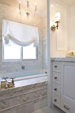 Lovely use of marble subway tiles in this bathroom by J. Steinberg Design. Especially adore the herringbone pattern on the side of the tub and the light fixtures. Modern and clean, yet soft and feminine.