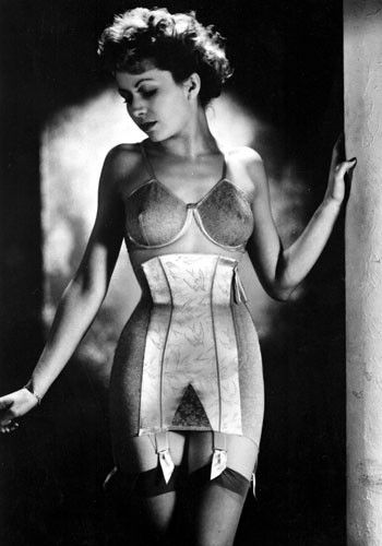1947  In the 1940s Christian Dior's revolutionary New Look required sturdy foundation garments to achieve an hourglass silhouette. A girdle was essential for the wasp-waisted look – this restrictive garment often extended below the hips and had suspender clips attached to hold up stockings.