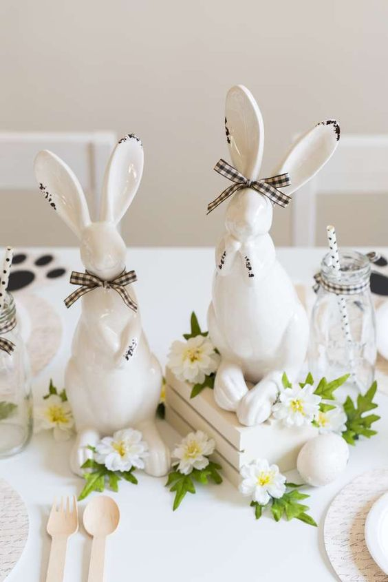 Loving the porcelain bunnies decorating the table at this Easter Party!! See more party ideas and share yours at CatchMyParty.com #catchmyparty #easterparty #decorations #eastebunny #centerpiece