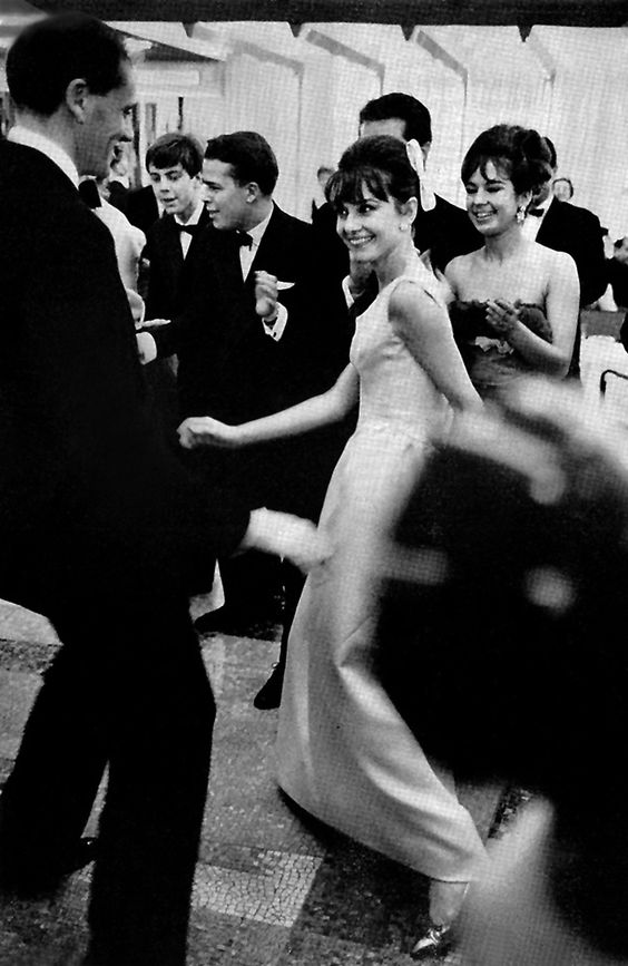 Audrey Hepburn, doing the twist with her husband, Mel Ferrer; at a charity ball aboard the new ocean liner SS France; Le Havre, France, 1962.