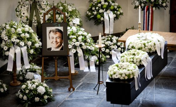 A picture taken on August 16 2013 shows the coffin and a photo of Prince Friso during the funeral service at the Stulp Church in Lage Vuursche in...