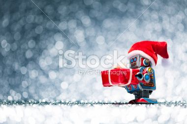 Retro tin toy santa robot holding christmas present Royalty Free Stock Photo >100