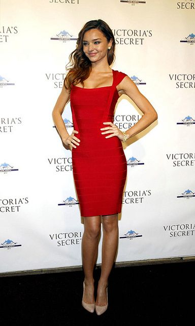 Miranda Kerr in a red angled bodycon bandage dress.  Get this look at http://www.sneakoutfitters.com/Bandage-Dresses/Red-Angled-Bodycon-Bandage-Dress-p2971.html#
