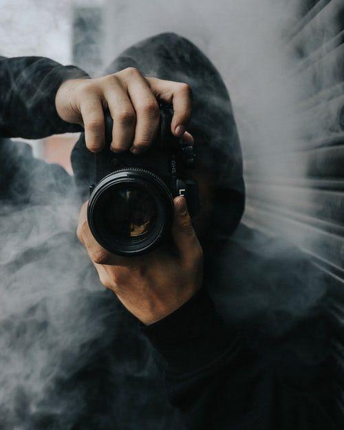 Man Holding Black Dslr Camera Boys Wallpaper Smoke Photography
