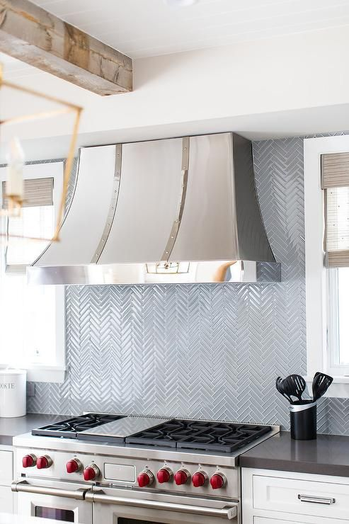 Stainless Steel Appliances With Blue Glass Backsplash Tiles Kitchen Hoods Kitchen Decor Modern Kitchen Design Decor