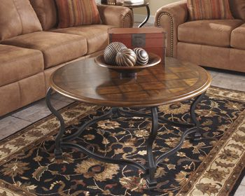 """The durable construction of the """"Wycliffe"""" accent table collection is the perfect venue for the sophisticated #OldWorld design that this furniture captures beautifully. The rich burnished finished table tops features the beauty of decorative inlay border frames surrounding a basket weave inlay with a sand shade color. The Old World beauty is further brought to life with the flowing shape of the wrought tubular metal base. Transform your home with #sophistication"""