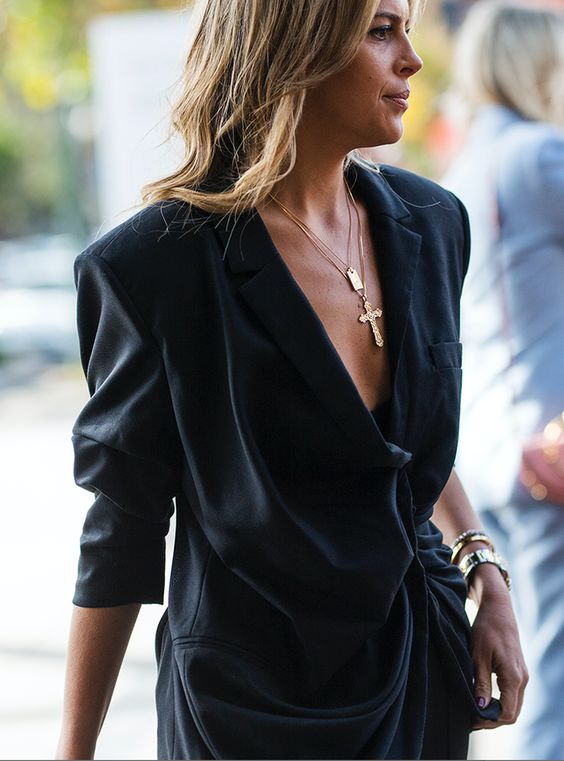 Australia Fashion Week Street Style from Sydney: A black draped blouse worn with a gold crucifix necklace