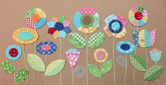 Because our BLOOM SEW ALONG starts one week from today... I thought I better show you what I ended up making with some of the patchwork flowers and leaves that I have been making during my latest tuto
