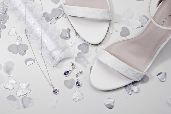 Why not tie in with your bridesmaids and add a subtle hint of colour? #loveargento #weddingjewellery #bride #bridesmaids #wedding #flatlay #jewellery