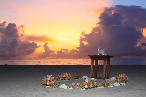 Sunrise ceremony with circle of flowers as an alter