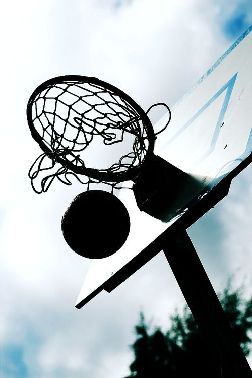 Cool action shot of the basketball going through the net.