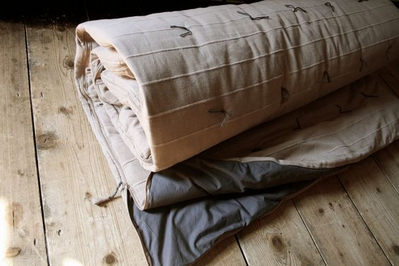 one of a kind, handmade, hand tied, large sleeping bag that can be fully unzipped for use as a double(UK) or full(US) size quilt.