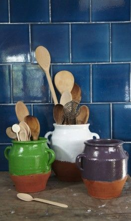 Rustic clay pots half painted with a strong wash of colou