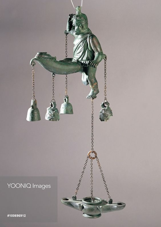 Tintinnabulum with oil lamps, by Unknown artist, 1st Century, Bronze. Italy: Campania: Naples: National Archaeological Museum: 1260. Whole artwork. Tintinnabulum man outsized phallus bells lamp - YOONIQ Images - Stock photos, Illustrations & Video footage