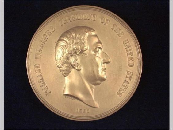 July 9, 1850: Millard Fillmore becomes the 13th President of the United States upon the death of Zachary Taylor.    Millard Fillmore Indian Peace Medal, after 1850, gilt bronze, engraved by Salathiel Ellis/ U.S. Mint/ Joseph Willson.  NYHS Object Number 899.