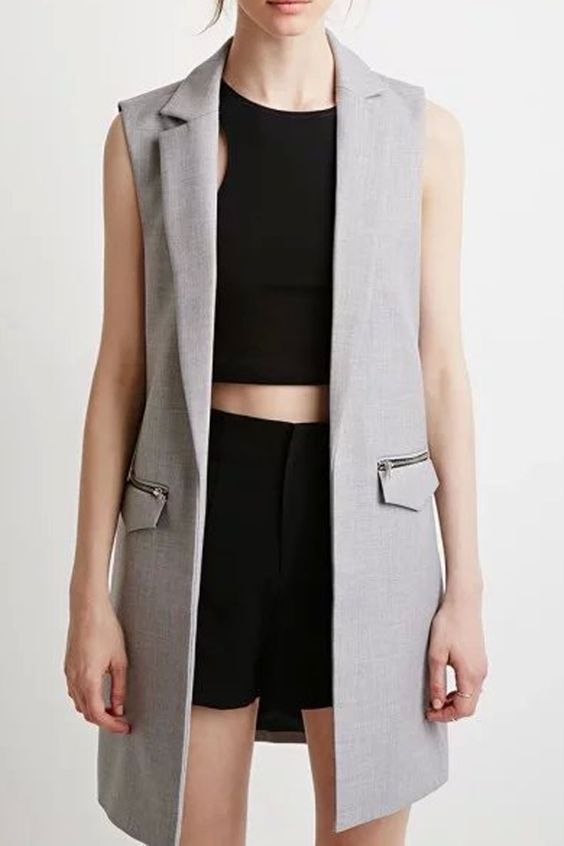 The vest featuring notched lapel and longline. Sleeveless. Open front. Flap pockets with zipper ornate.