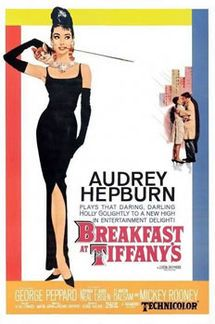 """Breakfast at Tiffany's is a 1961 romantic comedy film starring Audrey Hepburn and George Peppard, directed by Blake Edwards and released by Paramount Pictures. It was loosely based on the novella of the same name by Truman Capote. The film won two Oscars for Best Score of a Dramatic or Comedy Picture &Henry Mancini, Best Original Song: """"Moon River""""Henry Mancini & Johnny Mercer"""