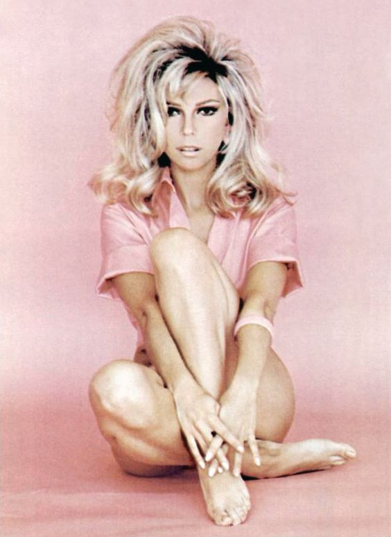 """The lovely Nancy Sinatra with very dark roots from an promotional photo for her single """"Hook and Ladder"""", 1970s."""