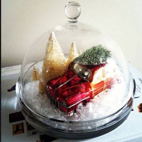 We love this #holiday decorating idea from @basicblackdesigns! All you need is a glass cloche, faux snow, mini trees and our Woody Car #ornament. #potterybarn
