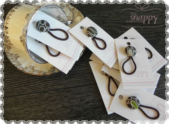 Covered button pony o's are sassy and playful and popular with females of all ages! They look great on a little girls' pigtails and just as awesome on a teen or adult ponytail!