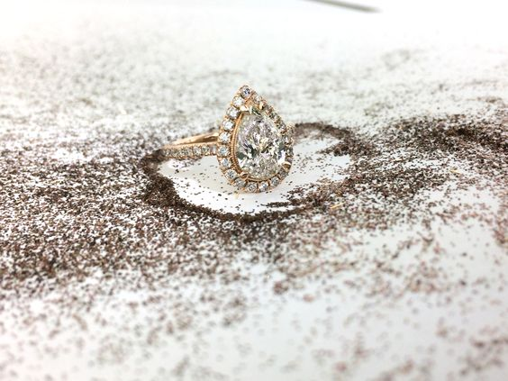 Amazing rose gold pear diamond halo engagement ring! So perfect!