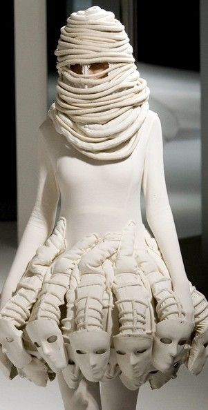 Take a gander at this awesome look.  White dress with a hidden face, but still lots of faces.