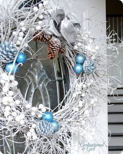 I have a gigantic, 6'X6' wreath in my entry way I feel the need to decorate every season!  Winter color scheme - blue, silver