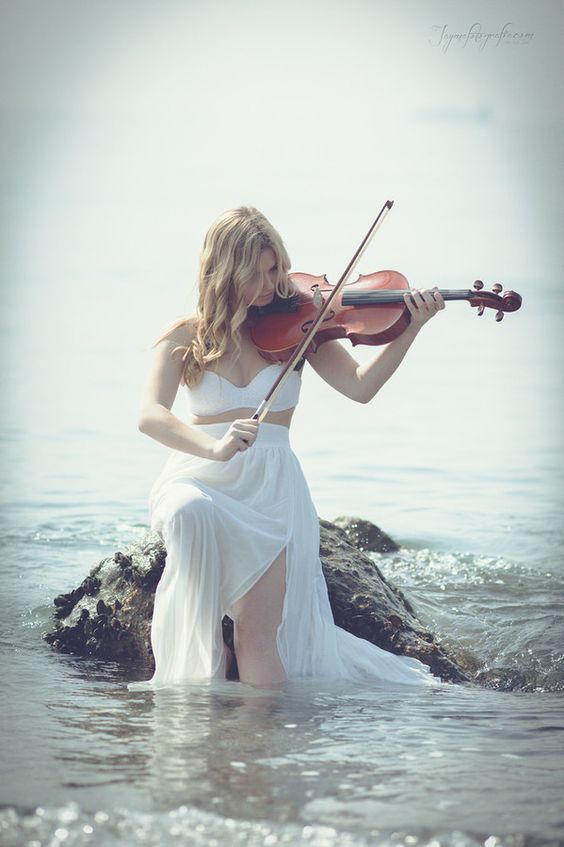 This picture annoys me so much she's not even holding any part of the viola right! Ugh<------- what kind of bow hold is that?!