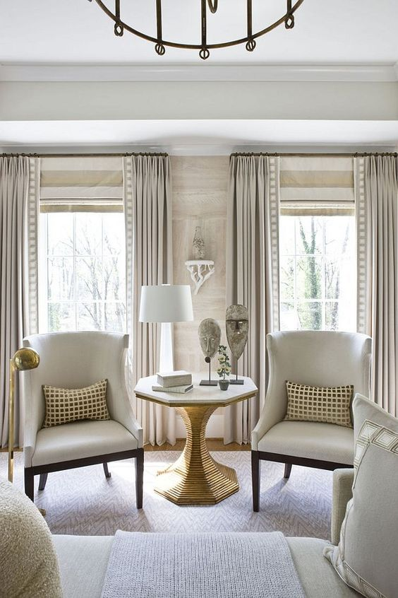 Living room with horizontal stripe roman shade – roman shade mounted at height of rod. Michael Hampton Design. Interior Design Ideas