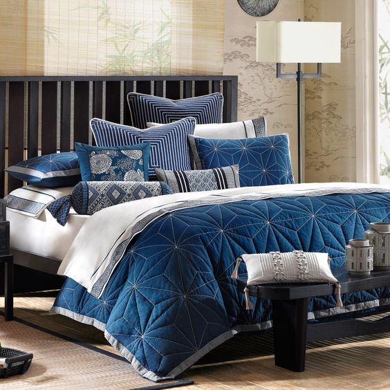 JLA Artology Sashiko Comforter Mini Set Decorate your master suite, loft or guest room with this beautiful sophisticated and trendy Comforter Set. The comforter is embossed with an indigo blue quilted face embellished with trim in gray to add the designer touch to your bedroom decor.