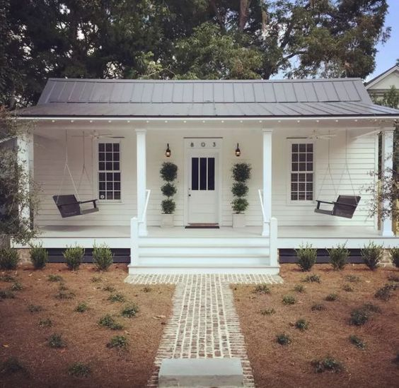 If ever a cottage had a picture-perfect porch, it's this sweet stunner.: