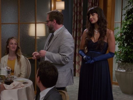 Tahani Al-Jamil's Navy Strapless Gown on The Good Place