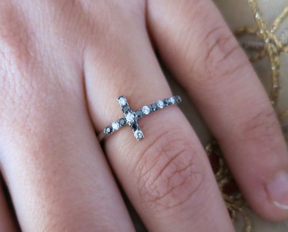 14k white gold micro pave set black and white round diamond cross ring. There is 15 diamond with a total weight of 0.23Ct. White diamonds are F color, SI clarity.