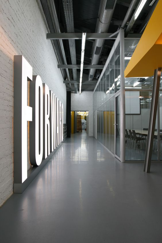 Cool walls concrete block walls and offices on pinterest for Cool office interiors