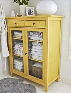 Baby room? This is the Ikea Hemnes linen closet repainted yellow.  The cabinet is great, and the color is so cheery!